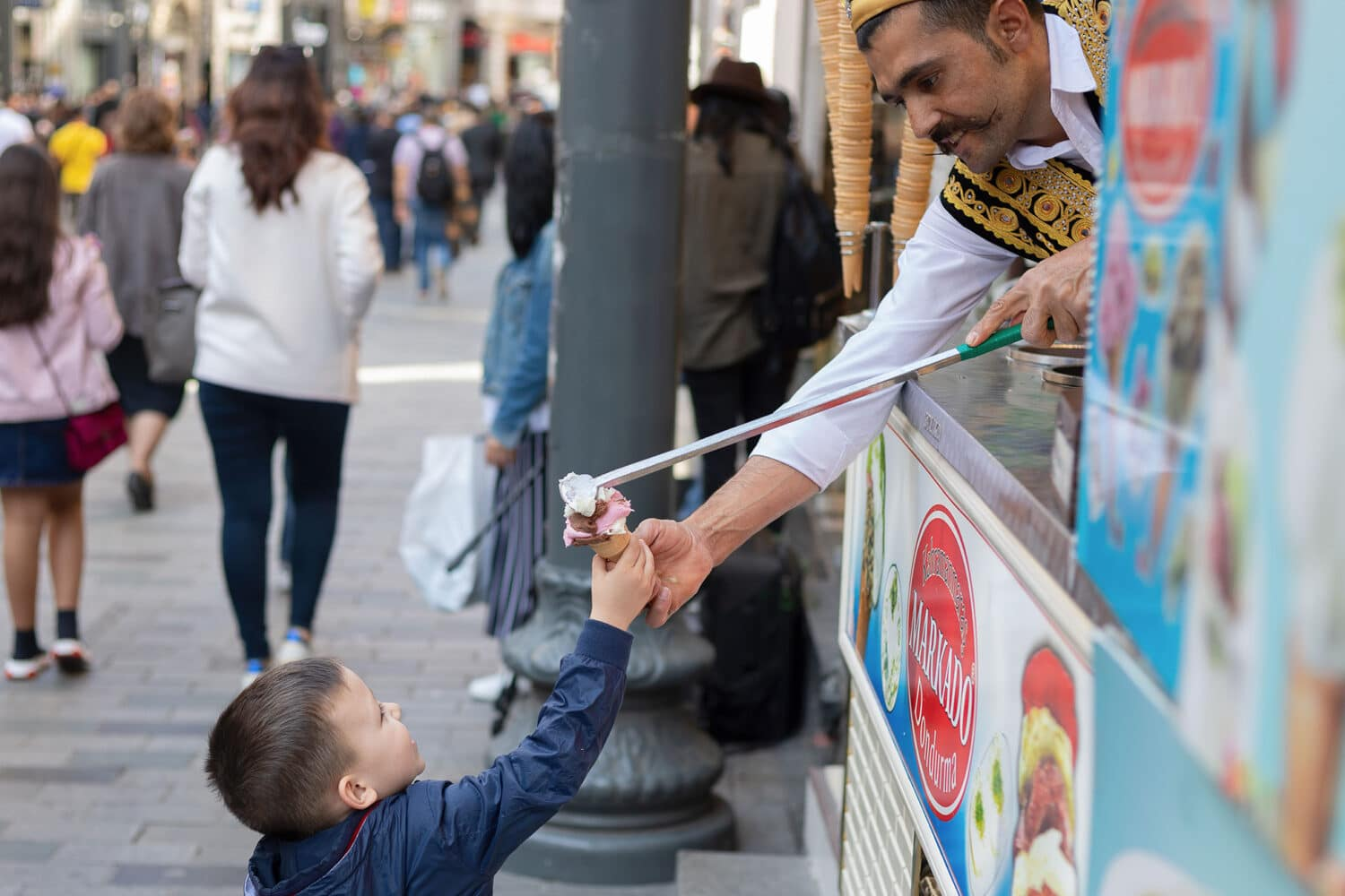 Tour Photos Kid Getting Ice Cream from Street Vendor in Istanbul